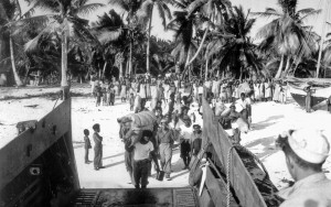 "An advance team of Bikini men board a landing craft to assist U.S. Navy Seabees in building new homes for the islanders on Rongerik. The Bikinians had to evacuate their island before ""Operation Crossroads,"" the U.S. military's nuclear test blasts at Bikini atoll in July, 1946. (AP Photo/file)"