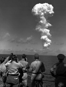 "Photographers and observers on the bridge of the USS Mt. McKinley watch a huge cloud mushroom over Bikini atoll in the Marshall Islands July 1, 1946 following an atomic test blast, part of the U.S. Military's ""Operation Crossroads.Jack Rice / File / AP"