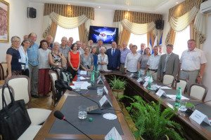 The Simferopol Rotary Club arranged a meeting with Simferopol city officials, the most prominent theme being the 'handshake screen' on both sides of the room. None of the Russian or U.S. participants that day could possibly go to war with one another!
